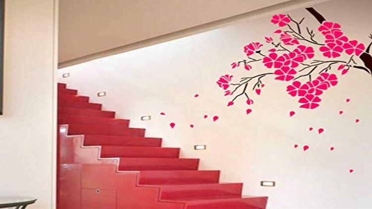 दीवारें बनीं कैनवास, कलाकार उकेर रहे झारखंडी संस्कृति